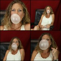 Laney Blowing Big Bubbles in White Tank Top & Red Background