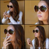 Gina Smoking with Large Sunglasses On