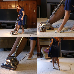 Vivian Vacuuming with the Kirby in a Blue Dress